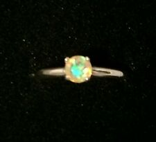 5mm round fire opal, set in size 7, Argentium silver ring.