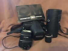 Olympus OM1 with 50mm lens, flash, zoom lens, case, owner's manual