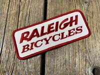 VINTAGE BIKE BICYCLE RALEIGH PATCH TRUCKER HAT BADGE APRON SHOP CREST EMBLEM NOS