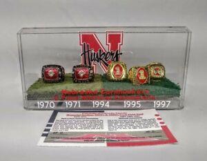 Nebraska Huskers Game Used Memorial Stadium 70's & 90's FIELD TURF & 5 RING SET