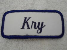 KRY  USED EMBROIDERED  SEW ON NAME PATCH TAG DARK BLUE ON WHITE