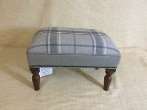 Footstool upholstered in a Laura Ashley Highland check Steel