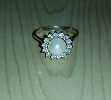 Anello golden ring Oro Giallo 750 18Kt con perla e zirconi taglio brillante.
