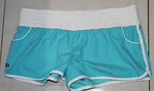 Womens size 14 teal & white shorts made by ROXY