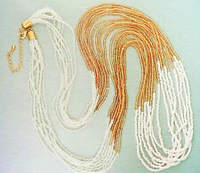 VERY LONG NECKLACE – 8 ROWS OF CREAMY PEARL, PALE AMBER & VERY PALE PINK BEADS