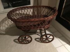 Vintage wicker large baby bassinet wagon wheels with metal support for canopy