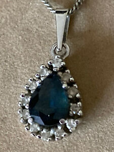 9 carat hallmarked white gold sapphire and diamond pendant with  white gold 16 i