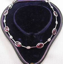 Garnet & Diamond Bracelet set in 9ct White Gold