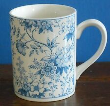 A blue and white Coffee mug in a traditional chintz pattern Johnson Bros