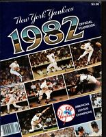 1982 Official Yankees Yearbook with uncut TCMA Cards- Mantle, Dimaggio, Berra