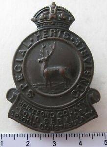 Herts ( Hertfordshire ) Special Constable lapel badge with long service scrolls