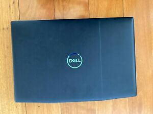Dell core i5 tenth gen, used, gaming laptop, black with blue back lights.