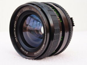 SIGMA 28mm f2.8 WIDE ANGLE LENS LENS IN OLYMPUS OM MOUNT