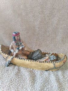 Native american indian figurines Indian In Canoe Ornament, 9 inches long