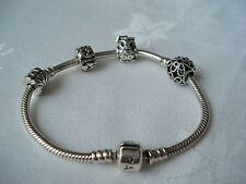 Genuine PANDORA Sterling Silver bracelet with 4 Pandora Charms - one with CZ