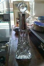 A large Edwardian sterling silver topped cut glass dresser bottle.