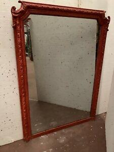 Miroir de style Napoléon III en bois et stuc patiné XX siècle