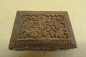 HAND CARVED IN RELIEF WOODEN NEEDLE CASE.