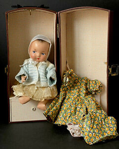 """Unmarked Vintage Composition 10"""" Doll with Trunk and multiple Outfits"""