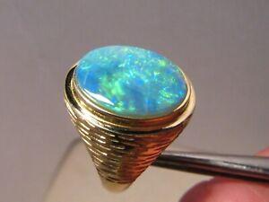 4.7 ct.  Large opal  Men's  Ring  13.1  grams  14 k yellow gold