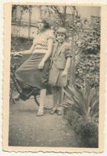 2 girls with a bicycle in garden - vintage photo