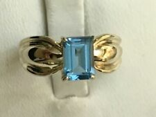 14k Yellow Gold 7x5mm Emerald Cut Blue Topaz Earrings