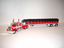 DCP 1/64 RED WITH WHITE STRIPES 379 PETERBILT WITH SPREAD AXLE COVERED WAGON