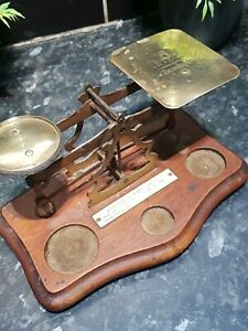 Antique brass postal scales for sale.