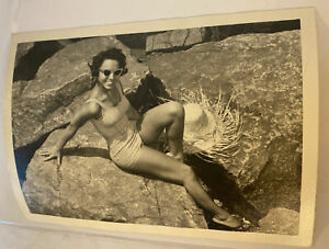 vintage African American woman pin up photo sitting on rock 1950s