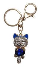 Porte-clés, bijoux de sac chat acier doré et cristal bleu et blanc.