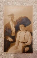 Vintage RPPC of a Beautiful Couple. Titanic type Clothing. Hats!