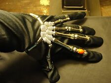 Costume Jewelry Silver Flex Skeleton Hand Bracelet and Rings with Red Stone