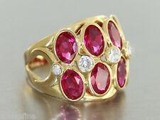 Gold 750  - Modischer Ring in 18 kt Gold (750/000) mit rubinroten Kristallen