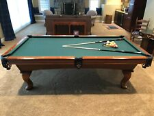Standard size Pool Table includes sticks and balls.