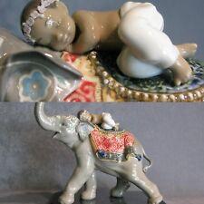 Porcellana Artistica. Elefante con bimbo Hawaiano