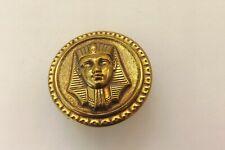 A VINTAGE BRASS METAL BUTTON AN EGYPTIAN GOD DESIGN 2.75CMS (1529)