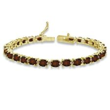 Oval-cut 6X4mm Garnet Tennis Bracelet in Gold Plated Sterling Silver