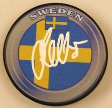 JACOB MARKSTROM SIGNED SWEDEN FLAG HOCKEY PUCK 1008619
