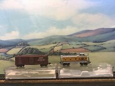Atlas N gauge Boxcar and caboose. Boxed.