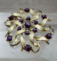 Hollywood vintage brooch Ribbon textured flower design w/  purple glass detail