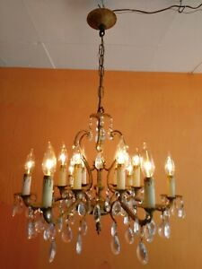 Ornate Vintage Spanish Brass Chandelier with 12 lights, 6 arms, lots of prisms.