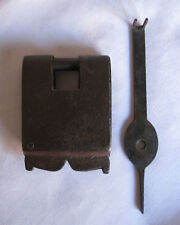 An old iron lock or padlock trick puzzle barbed spring mechanism with key