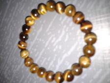 Bracelet en perles d' oeil de tigre, 1 rang, diamètre perles 6 mm, extensible.