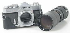 KONICA AUTO REFLEX T WITH 85-205 ZOOM LENS AND BOTTOM HALF OF CASE