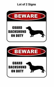 """2 count """"Beware Guard Dachshund (silhouette) on Duty"""" Laminated Dog Sign"""
