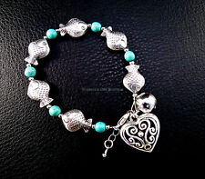 Turquoise bead bracelet w/ Tibetan silver fish filigree and charm of heart