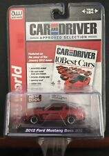 Auto World Car and Driver red 2012 Mustang Boss 302 and blue 1965 Ford GT40 lot