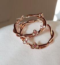 Delicate rose gold plated double twist pink rhinestones flower hoop earrings