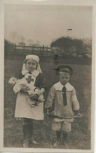 WW1 Patriotic Little Boy and his sister dressed as a Soldier and a Nurse