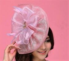 STUNNING PINK SINAMAY FASCINATOR WITH PINK FLOWERS, ORGANZA RIBBON AND CRYSTALS